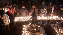 People lighting candles at temple on Durbar square,Kathmandu,Nepal Footage