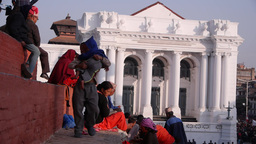 People sittinng on temple stairs with Old Royal Palace,Kathmandu,Nepal Footage