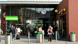 bus terminal station - people wait for the bus - commuter people - buildings - c Footage
