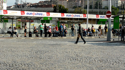 bus terminal station - people wait for the bus - commuter people - buildings in  Footage
