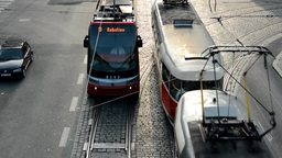 passing trams on the urban street - cars - view from above Footage