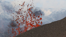 Eruption active volcano - emission from crater: lava, steam, gas, ash Footage