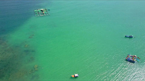 Drone Flies over Fishing Boats on Azure Sea Surface Footage