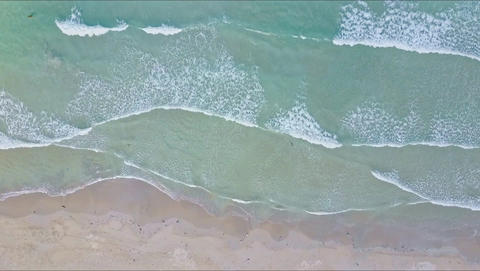 Aerial View Quiet Sea Waves Roll on Sand Beach Footage