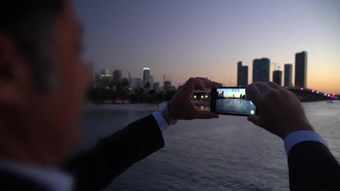 man Taking Smartphone Picture,sunset Miami Travel Footage