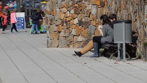Young Couple Sitting On Bench Footage