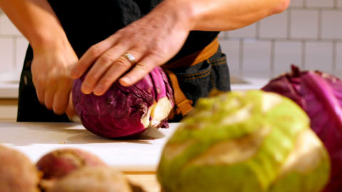Chef cutting purple cabbage in cafe kitchen Live Action