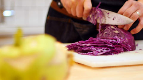 Chef chopping purple cabbage in cafe kitchen Live Action