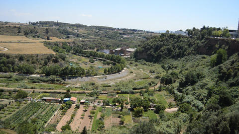 Vegetable Gardens And Old Factory Near Creek Footage
