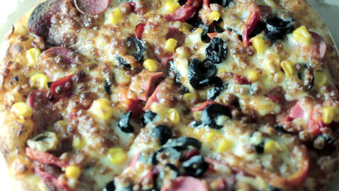 Close up pizza rotating on table, from above, top view Footage