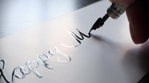 Happy Mother's day calligraphy and lettering post glossy card. Extremely close-u Live Action