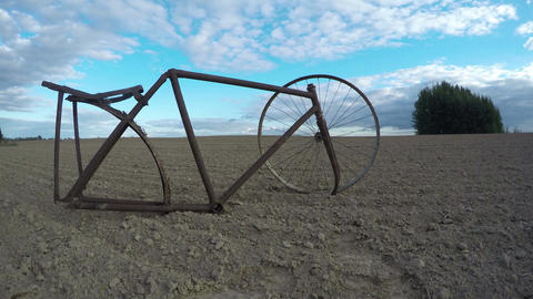 Remains of rusty bicycle in the field, time lapse 4K Footage