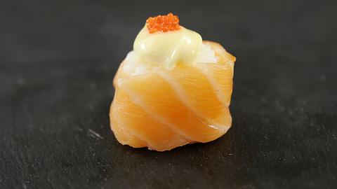 Sushi served on grey stone slate Live Action