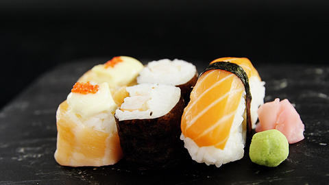 Set of assorted sushi served on gray stone slate Live Action
