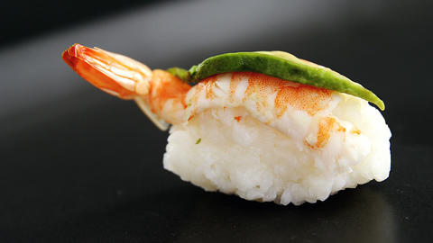 Sushi with shrimp served on gray stone slate Live Action