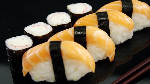 Maki sushi rool and nigiri sushi wrapped in nori seaweed Live Action