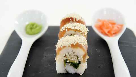 Nigiri sushi roll served on black stone slate Live Action