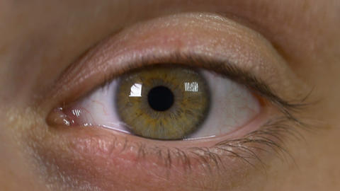 Macro view of man eye opening and being amazed Footage