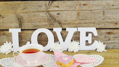 Cookies, tea, flowers and happy mothers day card with love text Live Action