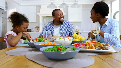Family having meal on dinning table at home Footage