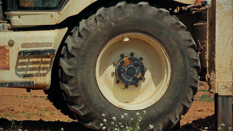 Tractor wheel rotating in the air tractor elevated above the ground Filmmaterial