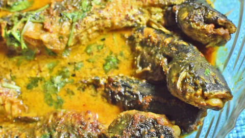 A plate full of Tyangra fishes , Bengali and Indian delicacy Live Action