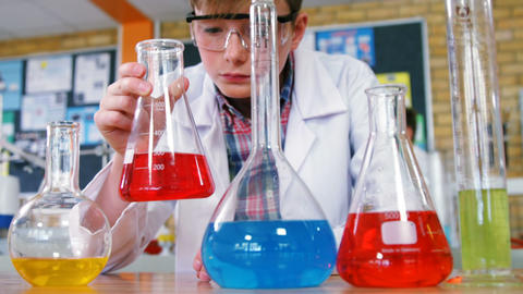 Attentive schoolboy doing a chemical experiment in laboratory Live Action