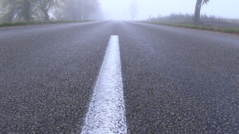 Asphalt road on foggy autumn day Footage