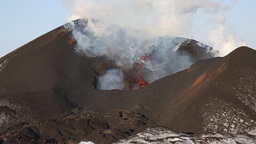 Eruption active volcano - effusion from crater: lava, gas, steam, ash. Kamchatka Footage