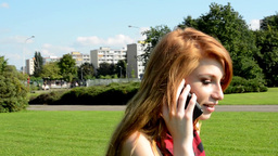 young attractive woman goes in park - nature - woman telephone Footage