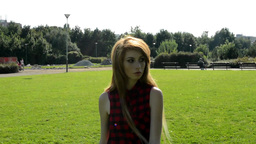 young attractive woman goes in park - nature in background - shot from legs Footage
