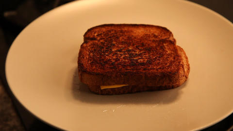 Placing a Grilled Cheese Sandwich on a plate Live Action