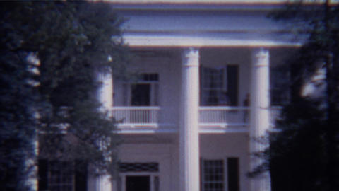 1966: Classic white pillar southern mansion house tourist traffic Footage
