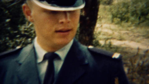 1966: Uniformed military man showing single gun bullet Live Action