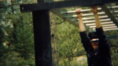 1966: Uniformed military cadet does monkey bars demonstration Live Action