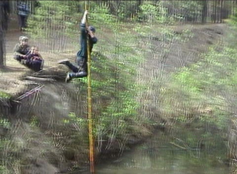 Sportsman overcomes water ditch by pole Footage
