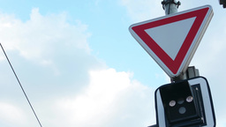 road sign - Stop and give right of way - traffic light for trams - lines Footage