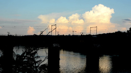 river with bridge for train - cloudy sky (sunset) - nature (trees and bushes) -  Footage