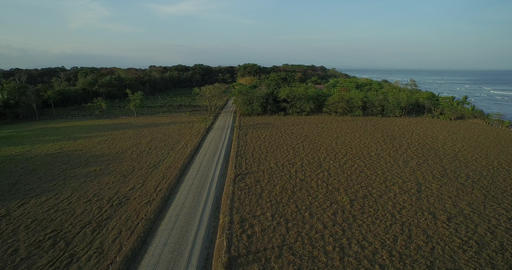Aerial View Of Long Road With Ocean On Right - Puerto Jiménez, Costa Rica stock footage