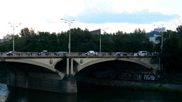 bridge over river with cars - nature (tress) and buildings in background - graff Footage