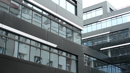 modern building - offices - windows - moderate rain - reflection of other buildi Footage