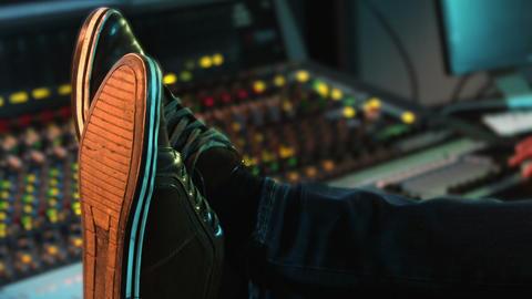 Audio engineer relaxing in recording studio Live Action