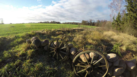 Pair of wooden wheels of horse carriage, time lapse 4K Footage