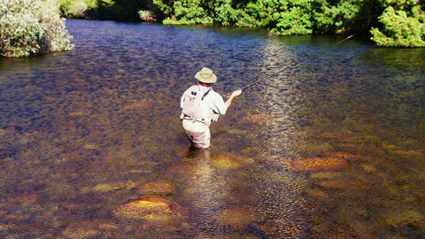 Man fly fishing in river Footage