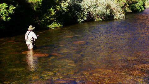 Man fly fishing in river Stock Video Footage
