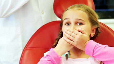 Young patient scared during a dental check-up Footage