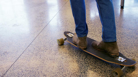 Executive skateboarding in office Live Action