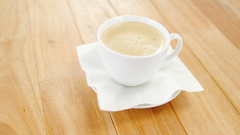 Close-up of white coffee cup with creamy froth Live Action