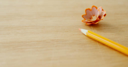 Close-up of yellow colored pencil with shavings Footage