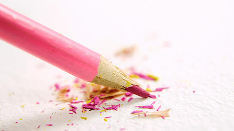 Pink broken colored pencil on white background Footage